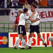 l-r; German goalscorers Miroslav Klose and Marco Bode celebrate