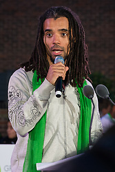 London, UK. 14 June, 2019. Rapper Akala reads out the names of members of the Grenfell community who lost their lives in the Grenfell Tower fire following the Grenfell Silent Walk on the second anniversary of the tragedy.