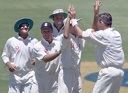 England bowler Andrew Caddick (right) gives Michael Vaughan a high five  as (l-r) Mark Butcher, captain Nasser Hussain and Chris Adams join them in celebrating the dismissal of South African captain Hansie Cronje during the third day of the 4th Test.