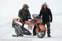 French custom bike builder Bertrand Dubet (L) with his partially streamlined Aprilia RSV4 racer with his mechanic / tuner Simon Ptelet at the Baikal Mile Ice Speed Festival. Maksimiha, Siberia, Russia. Wednesday, February 26, 2020. Photography ©2020 Michael Lichter.