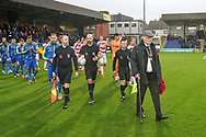 Players walking out with a poppy reef during the The FA Cup match between AFC Wimbledon and Doncaster Rovers at the Cherry Red Records Stadium, Kingston, England on 9 November 2019.
