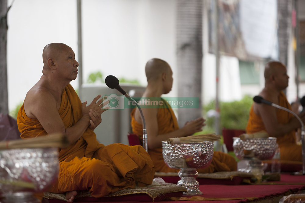 May 10, 2017 - Bangkok, Thailand - Visakha Bucha, the Buddhist holiday that marks the day of Buddha's birth, death, and day of reaching nirvana, is celebrated at Bangkok's Wat Pathum Wan on May 10th, 2017. Devotees came and offered donations of money and goods in order to make merit, as well as taking part in the tien wian procession at dusk, walking around the inner temple grounds at dusk holding lotus flowers and candles. (Credit Image: © Adryel Talamantes/NurPhoto via ZUMA Press)