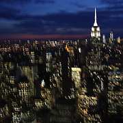 A panoramic view with movement of Manhattan, New York, at dusk from the Top of the Rock, the observatory deck at Rockefeller Center showing the Empire State Building, Manhattan, New York, USA.  Photo Tim Clayton