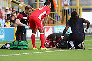 Scunthorpe United defender Cameron Borthwick-Jackson (3) down injured receiving treatment during the EFL Sky Bet League 1 match between AFC Wimbledon and Scunthorpe United at the Cherry Red Records Stadium, Kingston, England on 15 September 2018.