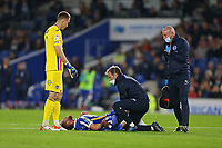 Football - 2021 / 2022 EFL Carabao League Cup - Round Three - Brighton & Hove Albion vs Swansea City - Amex Stadium - Wednesday 22nd September 2021<br /> <br /> Alexis Mac Allister of Brighton receives treatment after knee to the back from Steven Benda of Swansea as the keeper punches clear during the cup match at The Amex Stadium Brighton <br /> <br /> COLORSPORT/Shaun Boggust