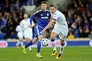 Cardiff City's Anthony Pilkington (blue) plays the ball past Leeds player Charlie Taylor. Skybet football league championship match, Cardiff city v Leeds Utd at the Cardiff city stadium in Cardiff, South Wales on Tuesday 8th March 2016.<br /> pic by Carl Robertson, Andrew Orchard sports photography.