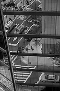 New York, reflection of the street on a mirror tower in colombus area