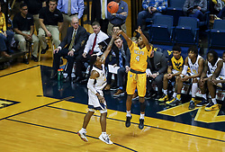Nov 24, 2018; Morgantown, WV, USA; Valparaiso Crusaders guard Bakari Evelyn (4) shoots a three pointer over West Virginia Mountaineers guard Brandon Knapper (2) during the first half at WVU Coliseum. Mandatory Credit: Ben Queen-USA TODAY Sports