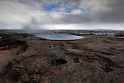 A geothermal Pool lets off steam at Geysir in South-West Iceland