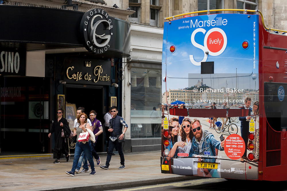 The southern French city of Marseille appears as an advert on the rear of a London tour bus travelling through the capital's streets, through Piccadilly Circus.