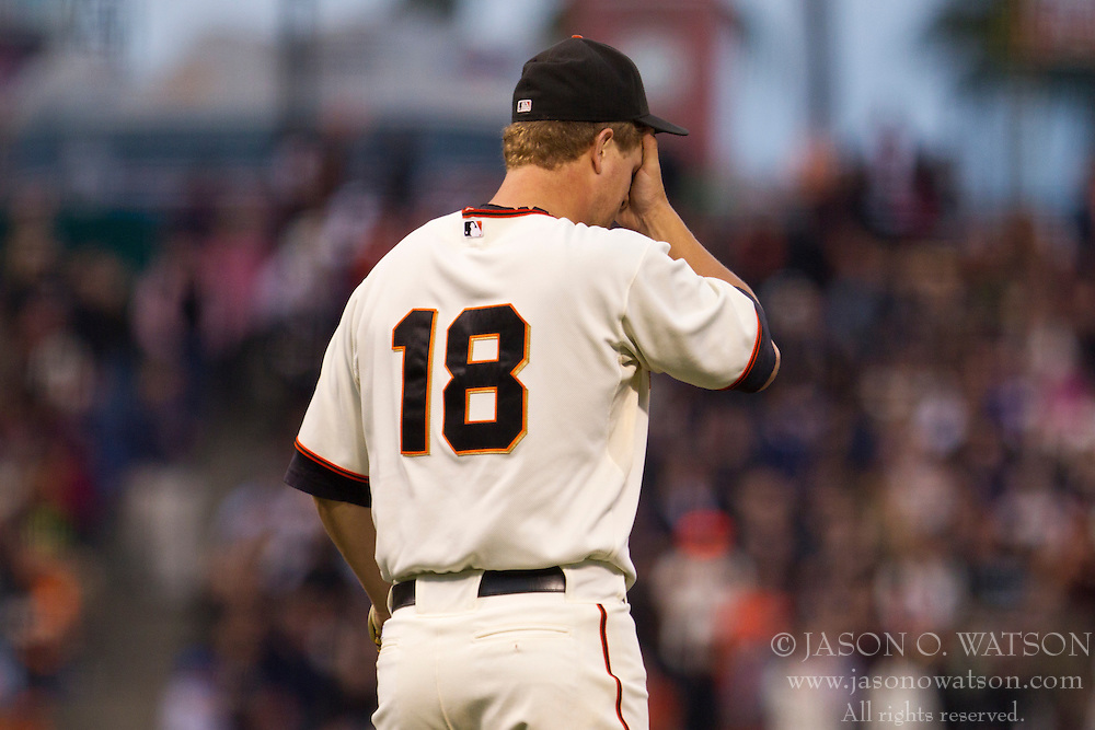 June 2, 2010; San Francisco, CA, USA;  San Francisco Giants starting pitcher Matt Cain (18) reacts after giving up a one run home run to Colorado Rockies shortstop Troy Tulowitzki (not pictured) during the fourth inning at AT&T Park.