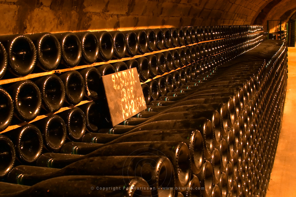 Rows of bottles of champagne ageing in the cellars of Moet & Chandon in Epernay Marne France