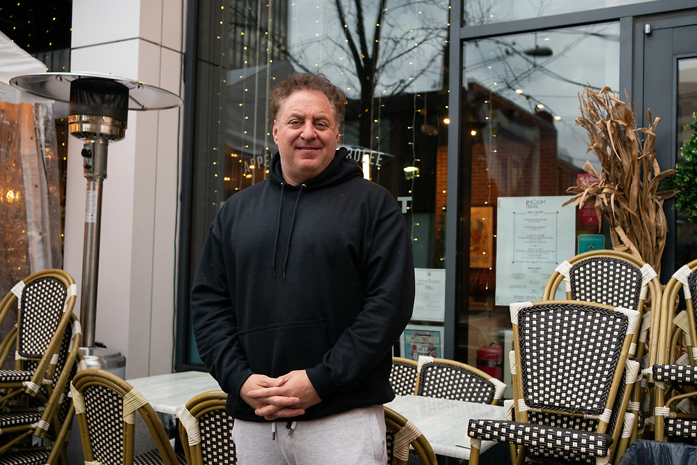 """Medium Rare chef and owner Mark Bucher, 52, stands for a portrait outside Medium Rare in Bethesda, MD on Wednesday, November 25th, 2020. """"This isn't a one-and-done model,"""" says Bucher. """"The restaurant business has changed forever and will need to change their model to survive."""""""