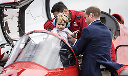 File photo dated 8/7/2016 of Prince George is lifted from the cockpit of a Red Arrows plane by his father the Duke of Cambridge during a visit to the Royal International Air Tattoo at RAF Fairford.