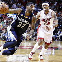 12 March 2011: Memphis Grizzlies shooting guard O.J. Mayo (32) drives past Miami Heat point guard Eddie House (55) during the Miami Heat 118-85 victory over the Memphis Grizzlies at the AmericanAirlines Arena, Miami, Florida, USA. **