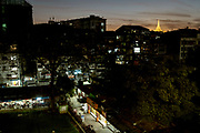 Shwedagon pagoda and old city buildings before sunrise, Rangoon, Yangon, Myanmar