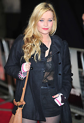 © Licensed to London News Pictures. 12/12/2011. London, England. Laura Whitmore attends the world premiere of The Girl With The Dragon Tattoothe first film in the three-picture adaptation of Stieg Larsson's literary blockbuster The Millennium Trilogy.  Directed by David Fincher and starring Daniel Craig and Rooney Mara  in Liecester Square London .  Photo credit : ALAN ROXBOROUGH/LNP