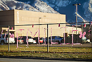 Pink ribbons line the fences of Ben Lomond High School in Ogden in memorial of the death of Emilie Parker, one of the children murdered during the recent school shooting at Sandy Hook Elementary, Thursday, Dec. 20, 2012