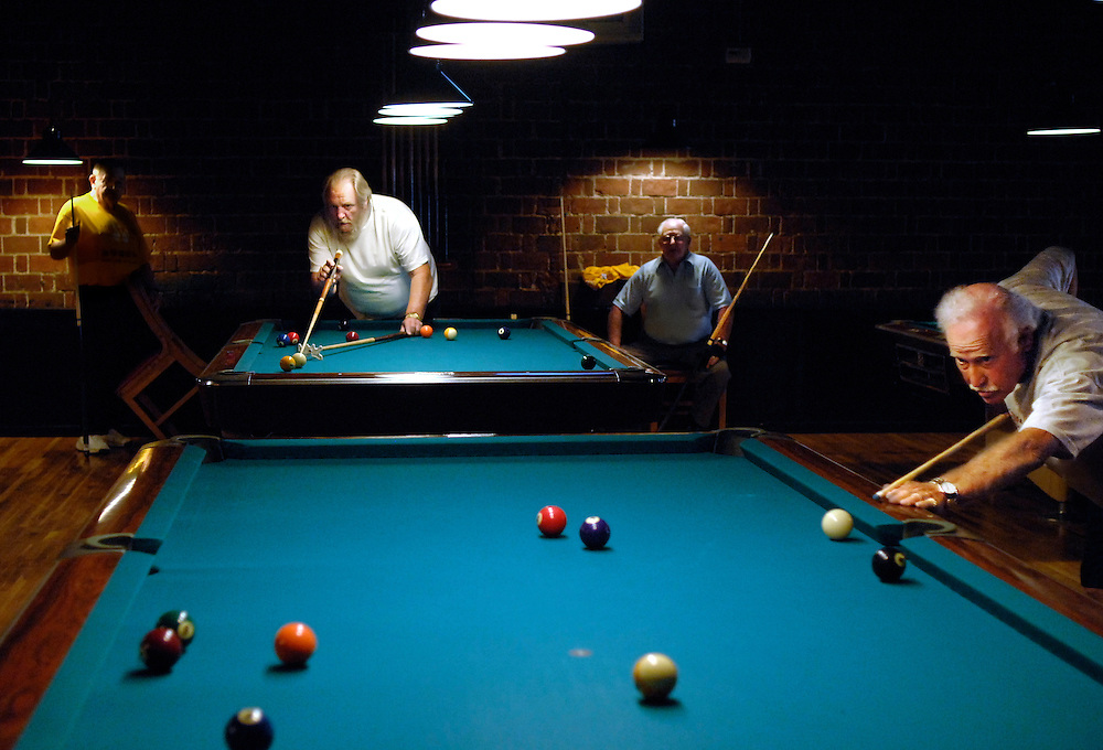 (Left to right) Bill Mabrey, William Gholson, Gordon White, and Robert Hall play in the first round of a single elimination billiards tournament at Billiards on Broadway.
