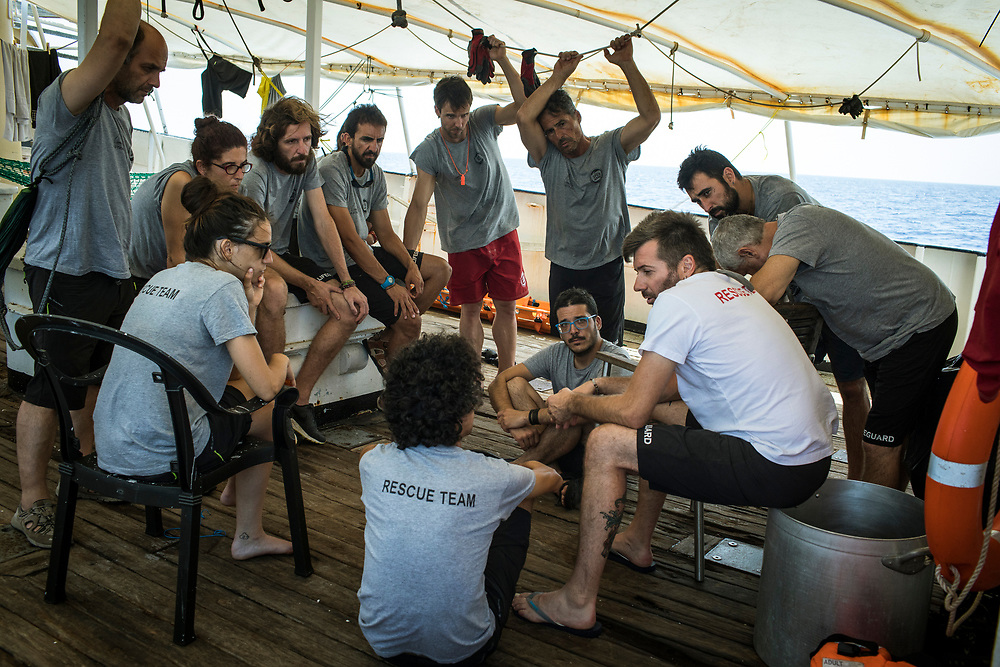 June 30th, 2017, Central Mediterranean. Riccardo Gatti, Head of Mission, comunicates the crew the death of Samuel the day after droping him off in Lampedusa. Evacuation of Samuel Osei, a 36-year-old man from Ghana severely sick after being rescued in the sea. NGO Proactiva Open Arms in their 20th rescue mission in the Central Mediterranean Sea on board of Golfo Azzurro vessel (photo Edu Bayer)