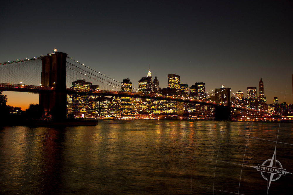 The Brooklyn Bridge at dusk with Manhattan in the background.