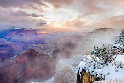 Clearing Snowstorm at Hopi Point in the Grand Canyon. Rushing to the Grand Canyon in a snowstorm isn't a wise driving or marital decision when the spouse would rather be taking a bathroom break but we photographers have our reasons. I got 3 images captured before the sun set behind me.