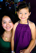 Happy Hmong mother and daughter enjoying the festival. Hmong Sports Festival McMurray Field St Paul Minnesota USA