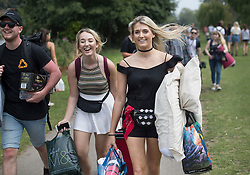 © Licensed to London News Pictures. 25/08/2016. Reading, UK. Music fans make their to Reading Festival. Mixed weather is expected to greet the start of the three day music festival. Photo credit: Peter Macdiarmid/LNP