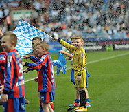 Mascots get a soaking at a sunny Huddersfield before the Sky Bet Championship match at the John Smiths Stadium, Huddersfield<br /> Picture by Graham Crowther/Focus Images Ltd +44 7763 140036<br /> 06/04/2015