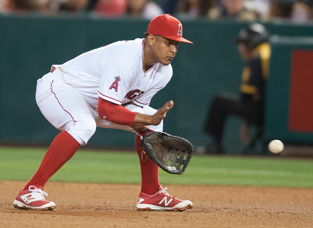 The Angels' Jefry Marte catches a Juan Uribe grounder to end the top of the fifth inning Friday at Angel Stadium.<br /> <br /> ///ADDITIONAL INFO:   <br /> <br /> angels.0611.kjs  ---  Photo by KEVIN SULLIVAN / Orange County Register  -- 6/10/16<br /> <br /> The Los Angeles Angels take on the Cleveland Indians Friday at Angel Stadium.