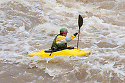 Woman kayaker in whitewater, Taos County, New Mexico