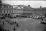 Funeral of President Childers.    (H62)..1974..20.11.1974..11.20.1974..20th November 1974..Following a period of lying in state, the remains of President Erskine Childers were removed today from Dublin Castle. The cortege would transfer the president to St Patrick's Cathedral where the funeral service would be held...Picture shows the Tricolour draped coffin aboard the gun carriage in preparation for the short journey to St patrick's Cathedral. In the background the family of the president and members of state and government make their way to the waiting cars.