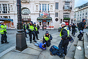 Police officers arrested a homeless black man, who said to be a supporter of the BLM at Piccadilly Square, in central London, Saturday, June 13, 2020. British police have imposed strict restrictions on groups protesting in London Saturday in a bid to avoid violent clashes between protesters from the Black Lives Matter movement and far-right groups that gathered to counter-protest.<br /> Anger against systemic levels of institutional racism has raged through the city, and worldwide; sparked by the death of George Floyd, who was killed in Minneapolis, US, by a policeman who restrained him with force on 25 May 2020. (Photo/ Vudi Xhymshiti)