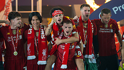 LIVERPOOL, ENGLAND - Wednesday, July 22, 2020: Liverpool's Neco Williams, Takumi Minamino, Curtis Jones, Harvey Elliott, goalkeeper Adrián San Miguel del Castillo and goalkeeping coach John Achterberg celebrate after being crowned Premier League champions after the FA Premier League match between Liverpool FC and Chelsea FC at Anfield. The game was played behind closed doors due to the UK government's social distancing laws during the Coronavirus COVID-19 Pandemic. Liverpool won 5-3. (Pic by David Rawcliffe/Propaganda)