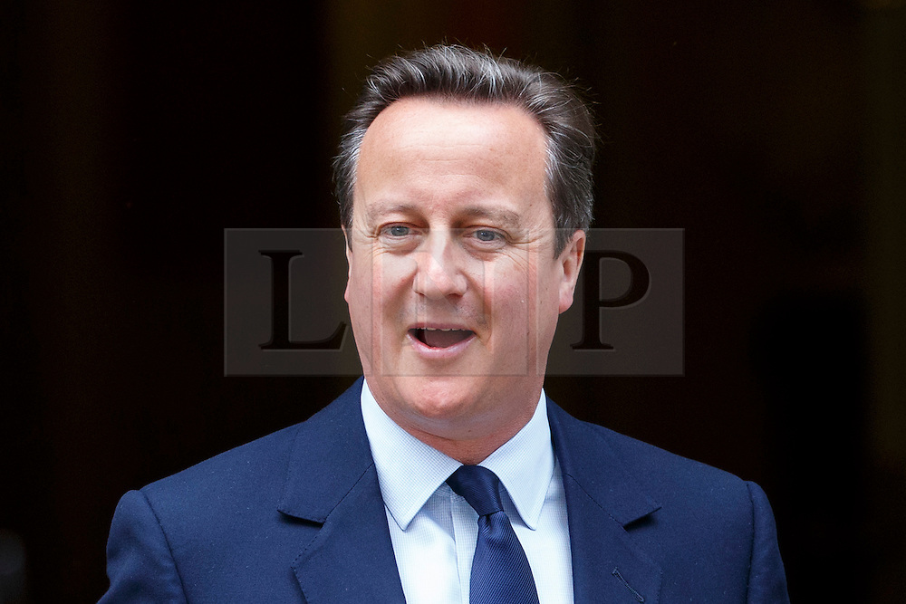 © Licensed to London News Pictures. 27/06/2016. London, UK. Prime Minister DAVID CAMERON leaves Downing Street to deliver a statement to the House of Commons on the EU referendum results on Monday, 27 June 2016. Photo credit: Tolga Akmen/LNP