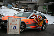 Clowns checks his make up in a police car mirror on the first day of the Strike WEF march on Davos on 18th of January 2020 near Davos, Switzerland. The first day of the march started in Lanquart with speeches and hot food and ended in Schiers.  The protest is planned to finish in Davos with a public meeting in the town on the day the WEF begins. The march is a three day protest against the World Economic Forum meeting in Davos. The activists want climate justice and think that The WEF is for the worlds richest and political elite only.
