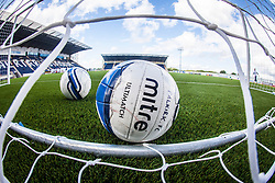 Footballs in the net during the warm up. The Falkirk Stadium, with the new pitch work for the Scottish Championship game v Morton. The woven GreenFields MX synthetic turf and the surface has been specifically designed for football with 50mm tufts compared with the longer 65mm which has been used for mixed football and rugby uses.  It is fully FFA two star compliant and conforms to rules laid out by the SPL and SFL.<br /> ©Michael Schofield.