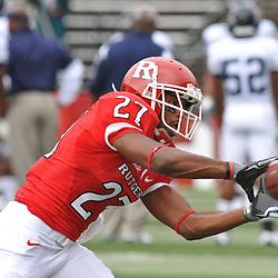 Sep 12, 2009; Piscataway, NJ, USA;  Rutgers cornerback Wayne Warren (27) makes a catch during warmups before Rutgers' 45-7 victory over Howard in NCAA College Football at Rutgers Stadium.