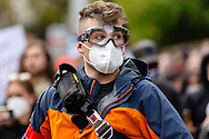 A man is seen wearing googles and a facemask amongst the 30,000 strong Black Lives Mater rally on 06 June, 2020 in Melbourne, Australia. This event was organised to rally against aboriginal deaths in custody in Australia as well as in unity with protests across the United States following the killing of an unarmed black man George Floyd at the hands of a police officer in Minneapolis, Minnesota. (Photo by Dave Hewison/ Speed Media)