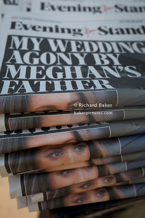 A stack of Evening Standard newspapers features the eyes of Meghan Markel, the American actor who is marrying Prince Harry in Windsor on Saturday and whose father is now said to not be attending, on 15th May 2018, in London, UK.