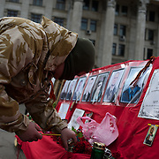 ODESSA, UKRAINE - March 16, 2014: A Pro-Russia protestor lights a candle at a shrine in memory of Berkut police men killed during the clashes in Kiev. Thousands gathered in Kulikovo pole square to demonstrate support for the referendum in Crimea. CREDIT: Paulo Nunes dos Santos