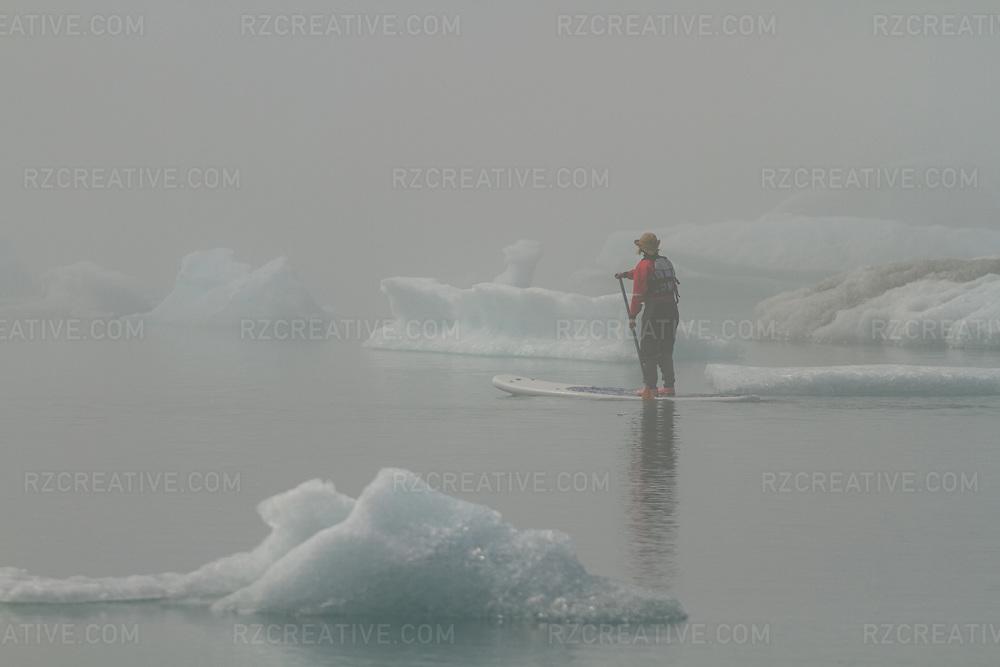 Paddleboarding near Bear Glacier in Kenai Fjords National Park, Alaska. Photo © Robert Zaleski / rzcreative.com<br /> —<br /> To license this image contact: robert@rzcreative.com