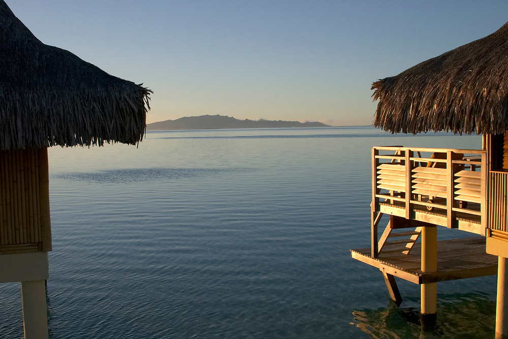 Overwater bungalows at sunset, Bora Bora, Society Islands, South Pacific