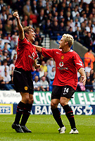 Photo. Jed Wee.Digitalsport<br /> Bolton Wanderers v Manchester United, Barclays Premiership, 11/09/2004.<br /> Manchester United's Gabriel Heinze (L) celebrates with Alan Smith after he knocks in his first goal for Manchester United.