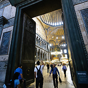 The Imperial Door to the main hall of the Hagia Sophia (Aya Sofya). In Byzantine times, only the emperor was allowed to pass through this doorway. Originally built as a Christian cathedral, then converted to a Muslim mosque in the 15th century, and now a museum (since 1935), the Hagia Sophia is one of the oldest and grandest buildings in Istanbul. For a thousand years, it was the largest cathedral in the world and is regarded as the crowning achievement of Byzantine architecture.