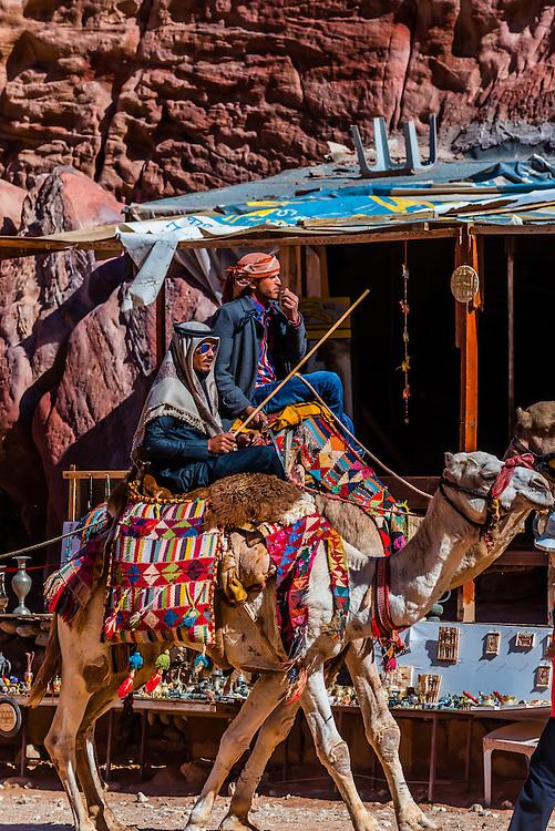 Bedouin men on camels, Petra Archaeological Park (a UNESCO World Heritage Site), Petra, Jordan.