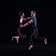 """Charlotte, NC -  Two dancers with the Paul Taylor Dance Company perform """"Lost & Found"""" during rehearsals at Halton Theatre on the campus of Central Piedmont Community College."""