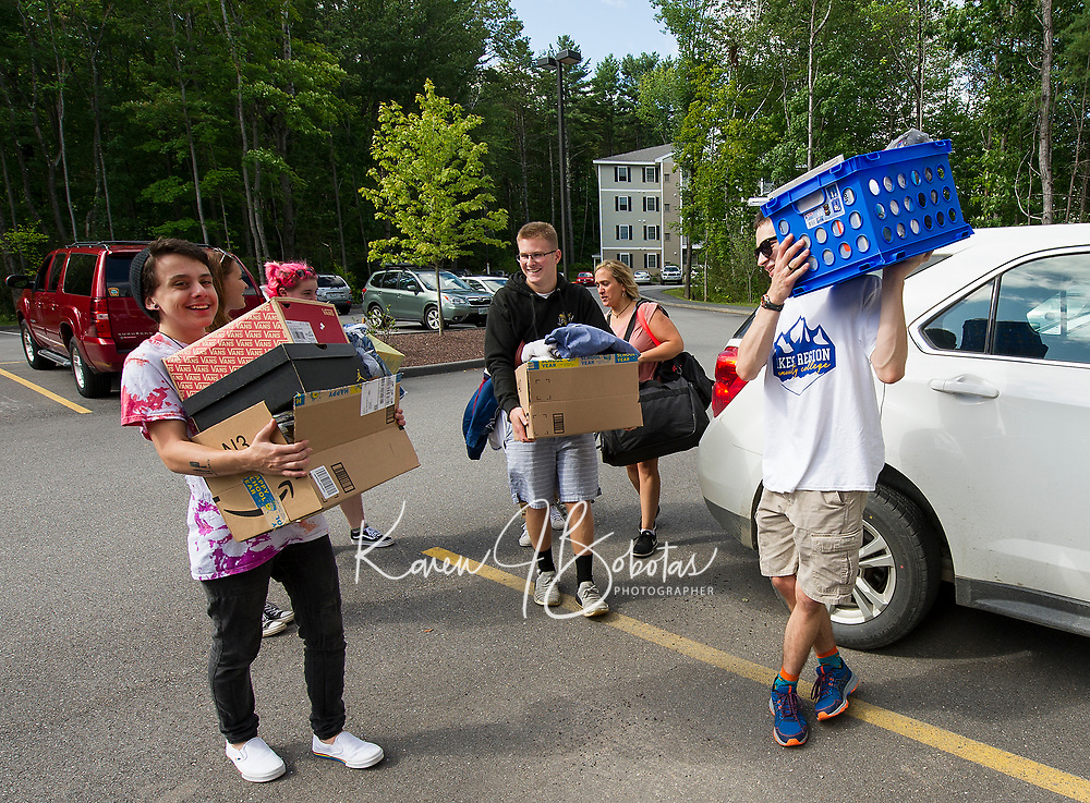 Hunter Judge (center of photo) gets plenty of help from fellow students Raymond Townsend, Katelyn Hazeltine, Blake Breault and Samual Avard during Lakes Region Community College during Move In day at the Apple Ridge student apartments on Sunday.  (Karen Bobotas/for the Laconia Daily Sun)