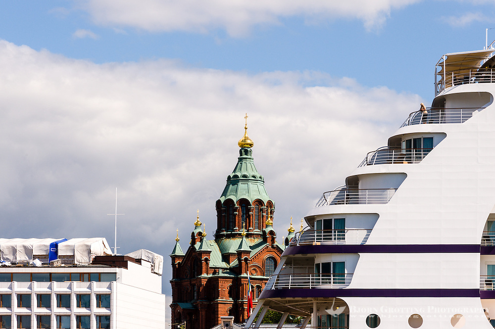 Finland, Helsinki. Uspenski Cathedral and a cruise ship.
