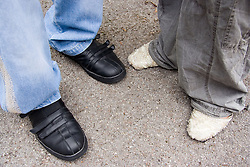 Feet of two teenagers in the street,